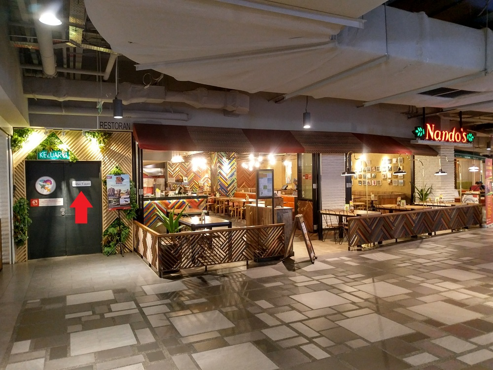 Calm Room located at Sunway Putra Mall lower ground floor, next to Nando's restaurant - note red arrow for entry door